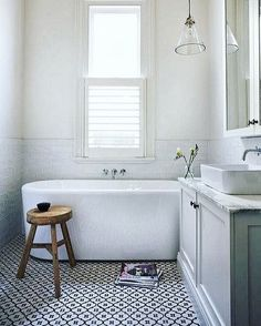 Keep it simple . Beautiful bathroom with free standing bathtub and tiles half wall. From @lillavillavita in Denmark. Love the bathtub and lamp.