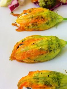 These roasted squash blossoms, stuffed with rainbow chard, basil, and chevre, make a light summer dish that's ready in under one hour. Squash Flowers, Zucchini Flowers, Zucchini Blossoms, Roasted Vegetable Recipes, Vegetable Dishes, Pumpkin Blossom Recipe, Stuffed Squash Blossoms, Eatable Flowers, How To Cook Zucchini