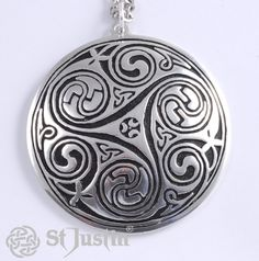Kells Key Spiral Pendant. Large pewter pendant with engraved Celtic triscele design on surgical steel trace chain. Product code: PN23. Price: £17.71 (exc. VAT). Available: www.stjustin.co.uk - All products are handcrafted in the United Kingdom.