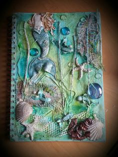 "Mixed Media - Journal ""Under da sea, under da sea.."" I made the mermaid tail, anchor and little fish from polymer clay. By Heather at Heather's Craft Studio"