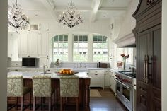 Arch over the sink, hood over the range and armoire refrigerator, coffered ceiling and chandelier - LURVE!!