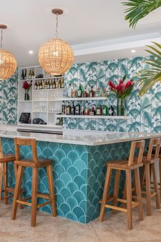 easily one of our most emerging popular cement tile shapes, the scallop is quickly coming into its own. this shape offers a soothingly soft repetition with a form that gives a nod to the nautical: think seashells, or even better–mermaids. shown here cement tile in kelly green on the kitchen / bar island. #cement #tiles #bar #design