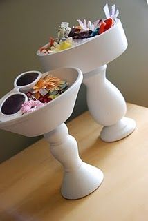 Paint dollar store wooden bowls. Glue to pedestal from the craft store. Fill with stuff! Done...