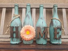 This is one of one our home sets. Beautiful to display on your mantels, tables, side table or anywhere in your home that you see fit. This is definitely an eye catching beauty. This is a set of four wine bottles standing at 11inch in HT. All bottles are painted with eden chalk