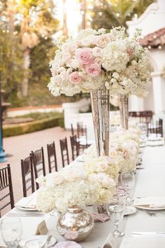 How gorgeous is this piece? Tall vases with soft pink flowers complete the table. We can recreate this look for you!