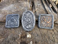 Crafted from polymer clay and intricate Celtic stamps. Textured and hand-painted with acrylics to give the impression of etched stone. Each attached with a thin magnet strip.  Each magnet measures approximately an inch across.  Colors may appear slightly different in person than they do on your computer screen.  This is a one of a kind item. Even though I may try to duplicate a process, just like in nature, no two pieces turn out exactly alike - all have a beauty unique unto themselves…