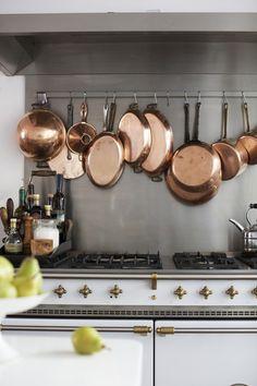 Kitchen Ideas. Copper pots and pans on a pot rack above the Lacanche range    frenchranges.com