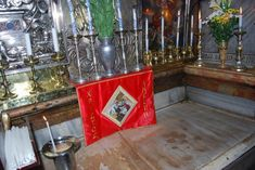 Interior of the tomb of Jesus.  This is in a small room AT THE BACK of the most popular tomb.  I read that Jesus' actual burial place is BENEATH this small room, and no one is allowed to even go down there for archaeological purposes.
