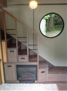 Fireplace or TV could be Tucked under the stairs