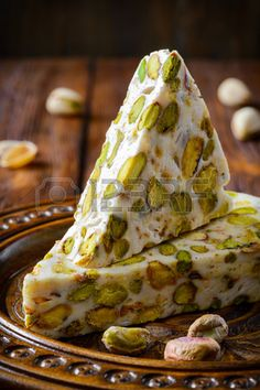 Turkish delight. Arabic dessert with and Pistachios on wooden plate. Selective focus