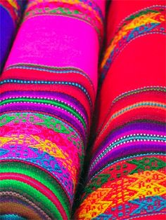 Beautiful Rainbow Colored Carpets. These would make such a bright and colorful addition!