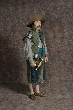 Sancho in stock shirt, green tunic w/grey tabs, blue & grey velvet patch pants, sash, hat l Man Of La Mancha, Patch Pants, Green Tunic, Don Quixote, Larp, Costume Design, Blue Grey, Costume Rental, Hipster