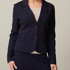 AISHA elegant jacket, dark blue. This jacket has an elegant look while it's comfortable to wear because it's made in stretch and without lining. The seams inside the jacket is covered in dotted fabric that so it looks elegant both on the inside and on the outside of the jacket.  Coloured by the eco-tex standards.