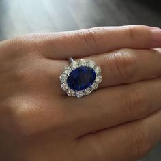 Platinum Sapphire 1.88ctw Diamond Ring This Platinum Blue Sapphire Ring is jaw dropping! This ring is made with Platinum and features 1.88ctw diamonds and a stunning 7.02ct large center sapphire st…