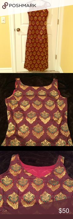 Indian dress Gorgeous silk dress with floral pattern. Maroon color - with teal and gold motifs. Boat neck. Back neckline shown in third picture. Side slit till knee on one side of the dress. Zipper on the side. Bought it from India. Dresses Maxi