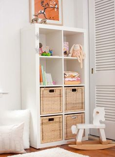 Shelving with room for toys in the baskets. To place in between closet and window.  Or behind door