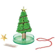 Grow your own Christmas Tree to decorate with your kiddos! This Magic Christmas Tree by Moulin Roty grows within 5 to 6 hours once you spread the branches and pour in the special water. Make sure to add the garland and star before you pour in the water. Cardboard Tree, Tree Watch, Baby Learning Toys, Red Garland, Paper Tree, Theme Noel, Christmas Tree, Christmas Ornaments, Tree Branches