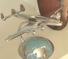 ~~Aviation aficionados will love this Art Deco Desktop model airplane in their home or office. The cast aluminum plane flies over blue enamel and aluminum globe stand, as if your flying over the world. | eBay!