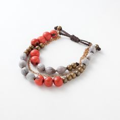 Napo Bracelet | $38 | Acai seeds and chains offer a delicate balance of metals and natural materials. Handmade in Ecuador this three-in-one look will brighten your wardrobe.