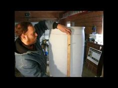 Vertical gardening is one of the most space-efficient ways to grow. I show you how to build your own vertical garden planter from a recycled plastic barrel t. Vertical Garden Planters, Barrel Planter, Edible Garden, Outdoor Projects, Raised Beds, Hydroponics, Outdoor Gardens, Gardening, Net