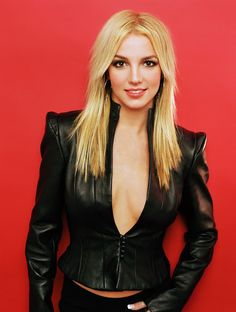 Here's Britney Spears from a photo shoot by Mark Liddell from Brit is wearing this black leather outfit, standing in front a red ba. Britney Spears Photos, Britney Jean, Female Singers, Celebs, Celebrities, Shakira, Miley Cyrus, My Idol, Kim Kardashian