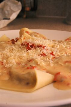 Mushroom ravioli with sun dried tomato cream sauce