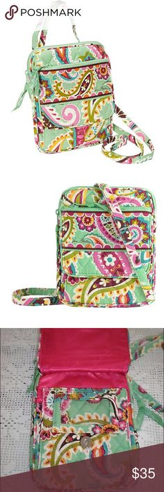 """NWT Vera Bradley Mini Hipster Crossbody All components of a wallet built into the bag! Magnetic snaps. 6 interiors slots, ID window and Zip Pocket. Adjustable shoulder strap. Zip top closure. Back curved slip pocket. 6"""" W x 7 1/2"""" H x 3/4"""" D with 56"""" adjustable strap. Print is Tutti Frutti and no longer sold by Vera Bradley Vera Bradley Bags Crossbody Bags"""