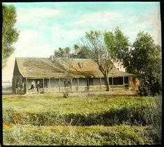 An adobe house at 9th and Mateo, circa 1900, in what's now L.A.'s downtown arts district. Hand-colored lantern slide