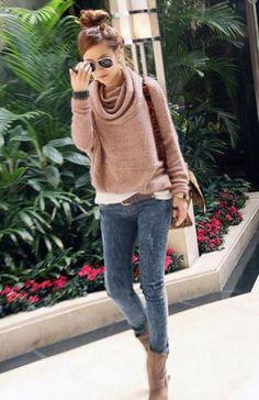 Bun. Tan sweater. Jeans. Boots.