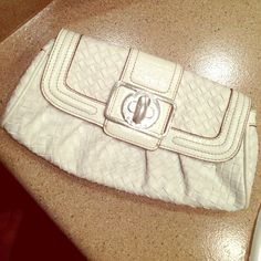 Guess White Clutch White clutch. Leather feel. No scratches or huge stains. One tiny blue dot on the back towards the bottom. 10 inches long, good size, can hold a lot. Guess Bags Clutches & Wristlets