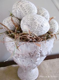 Decoupage plastic Easter eggs - old hymnal pages, Modge Podge, clear glitter.