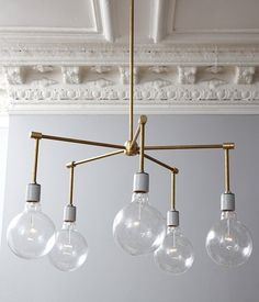 16 Crazy-Easy Ways to Make Over a Dated Chandelier: Feeling ambitious? Make this modern brass fixture from start to finish.