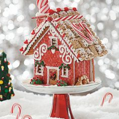 """""""Home Sweet Home"""" Gingerbread Cottage Recipe -I love to see the end of a project, like this Christmas cottage—but my favorite part is the process. It's fun to watch the gingerbread, icing and candy decorations come together creatively. —Johanna Rosson, Fort Hood, Texas"""