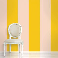 Yellow striped temporary wallpaper, could be nice as an accent wall in a kitchen/breakfast room area. More than that, definitely overwhelming.