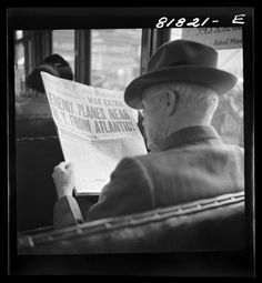 Reading war news aboard streetcar. San Francisco, California. December, 1941.