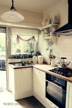 Use white to make it feel bigger and brighter. I love the brick backsplash and the open shelving. This old style kitchen is perfect.