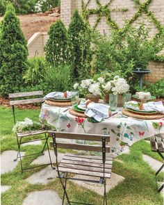 Tucked away in a peaceful setting, a whimsical watercolor linen sets a fanciful tone for this elegant tabletop. #southernladymag #tablescape #tablescapes #tablescapestyling #tablestyling #styling #tablescapetuesday #tabletoptuesday #entertianing #southernentertaining #alfresco #diningalfresco #garden #southerngarden #springinthesouth Southern Ladies, Outdoor Furniture Sets, Outdoor Decor, Garden Gates, Backyard Patio, Tablescapes, Table Decorations, How To Plan, Patio Ideas