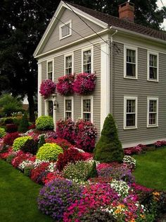 Curb appeal with beautiful colors makes this house pop. You don't need to have this much variety.  You can keep it simple and get eye catching curb appeal.
