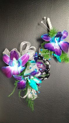Prom night with a touch of blue, teal and purple.. Dendrobium orchids and rhinestones for bling. And a lovely wristlet for a keepsake.