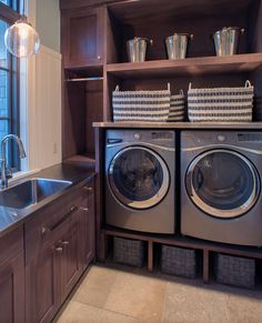 Love the idea of having the appliances raised off the floor, and of using the space below for storage!