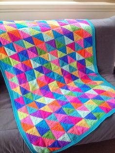A gorgeously colourful blanket inspired by the quilting world. This is such a versatile pattern. You can change the look completely depending on your colour choices and layout. Use as many or few colours as you like. 15 pages of clearly written instructions with photos for the tricky bits.Also includes templates and alternative layout ideas to design your own stunning masterpiece.This pattern is easy to customise by adjusting the number of squares in each row. Make it any size you like –…