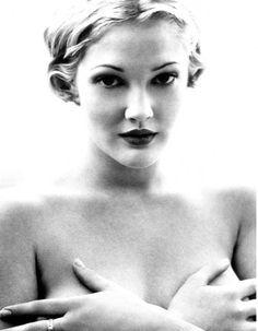 Drew Barrymore she was my high school girl crush...I three other girl crushes too..... Lol