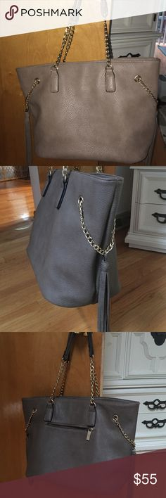 BOUTIQUE BROWN AND GOLD LARGE TOTE W SIDE FRINGE FUN AND STYLISH LARGE TOTE.. Many compartment and very useful!  NICE SOFT LEATHER.. BARELY USED.. GREAT CONDITION!! Purchased at local boutique Bags Totes