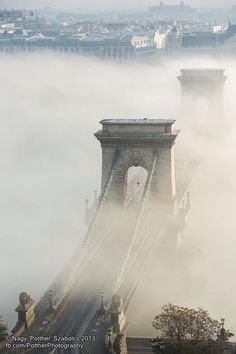 The Széchenyi Chain Bridge rises through the Autumn fog in Budapest, Hungary.