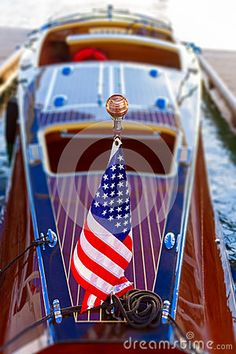 Classic wooden boat with American flag proudly flown