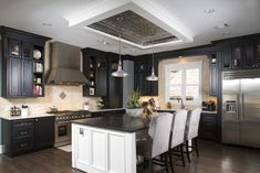 Printed tin plates for visually intriguing mix on a traditionally plain ceiling #ceiling #tin #kitchen