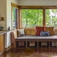 Accentuate windows with cozy seating areas that also double as added storage!