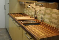this is the dream! a must-have in my future kitchen. instead of countertops, all wooden/plastic cutting boards.
