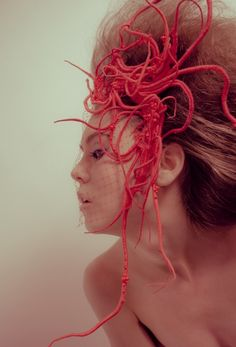Parisian artist and designer Lorenzo Nanni combines embroidery,beadwork and needle felting to create organic forms ranging from intricate arterial systems to octopi. Some are wearable prostheses, some are simply art, and some form the world of Naiade, a film for which Nanni did much of the costume and set design.