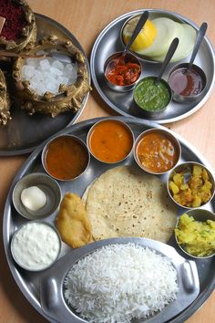 Indian thali - meal made up of a selection of various typical dishes including rice, dal, vegetables, roti, papad, curd (yoghurt), small amounts of chutney or pickle, and a sweet dish to top it off.Thali dishes vary from region to region and are usually served in small bowls, called katori, which are placed on a round tray, the actual thali - often a steel tray made with multiple compartments is used. #food #culture #india #cuisine